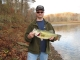 SPORTFISHWORLD FISHING PHOTO   USA   FISH SPECIES  Largemouth Bass    Tim McDaniel with an 5 pound Largemouth Bass from Patoka Lake in  Indiana.  Hit on a white spinner-bait in the early morning of 11/6/05..     SportfishWorld © 2003 Bob Fisher