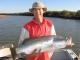 SPORTFISHWORLD FISHING PHOTO   AUSTRALIA   FISH SPECIES   Barramundi    Rob Bruynel with an 88cm Barra caught in the Turner River system...Leith Larham   SportfishWorld © 2003 Bob Fisher