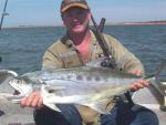 Australia|Western Australia|Pilbara Region|Port Hedland|Shane Baker with a Port Hedland Queenfish...Copyright SportfishWorld © Bob Fisher
