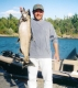 SPORTFISHWORLD FISHING PHOTO   CANADA   FISH SPECIES  Chinook Salmon    Jeff Jankowski from Cleveland, Ohio caught this 20 lb. Chinook salmon that was travelling from the Georgian Bay to spawn in the French River Delta, while he was staying at Bear's Den Lodge during fall.  www.bearsdenlodge.com   SportfishWorld © 2003 Bob Fisher