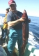 Fishing for Giant Humboldt Squid - Cordell Bank: Giant Humboldt Squid: RICH PHARO on the Giant Humboldt Squid Trip aboard the New Sea Angler at the Cordell Bank off Bodega Bay in 2006 -  photo Bob Fisher. SportfishWorld &copy Bob Fisher