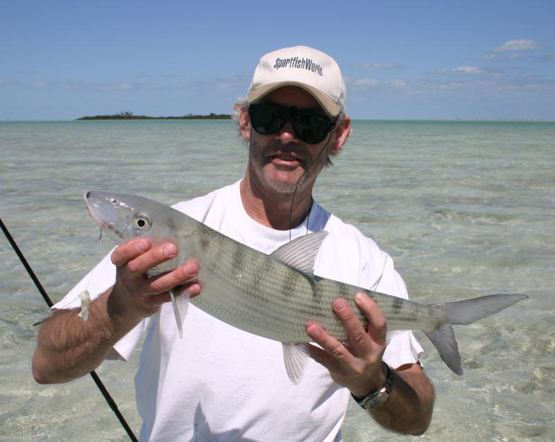 WORLDWIDE SPORTFISHING PHOTOS, Bahamas,   Bonefish, SportfishWorld's Bob Fisher with a Bahamas Bonefish caught at Joulters Cay near Andros Island with second-generation Bonefish Guide Franklin Russell. SportfishWorld has contacts on North Andros Island and can assist you in planning your Andros Island Bonefishing trip.