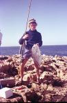 FISHING CAPE CUVIER IN THE SEVENTIES Fishing Photos   Trevally Russell <b>'Rusty'</b> Stone with a Trevally caught spinning from the rocks with a Mitchell 499 at High Rock, Cape Cuvier, Western Australia. Bob <b>'fishmaster'</b> Fisher Photo 1979. SportfishWorld © Copyright 2003 Bob Fisher's SportfishWorld &copy
