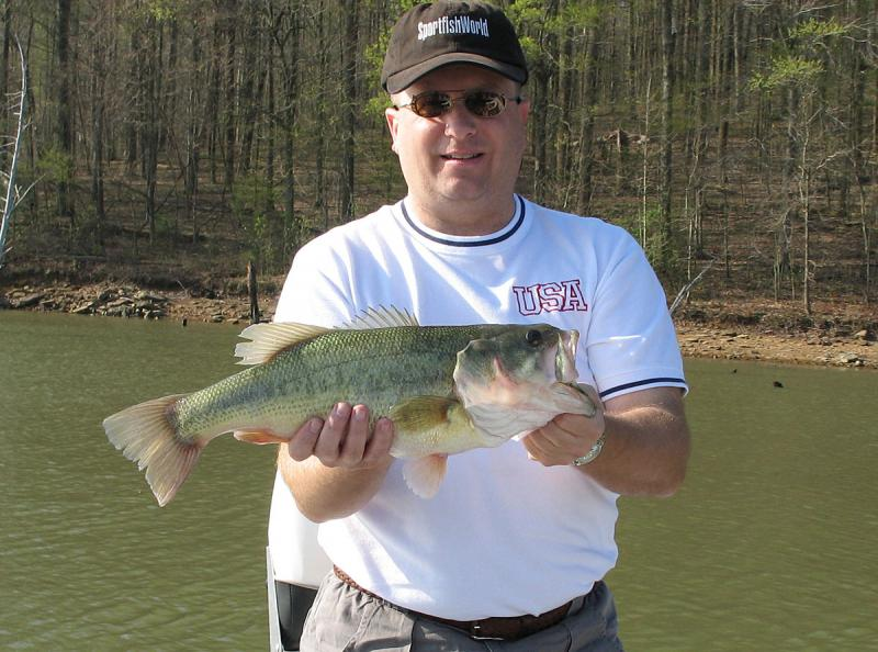 Fishing in Indiana, Fishing Photos,  Largemouth Bass, Tim submitted this photo of his brother with a nice Largemouth Bass