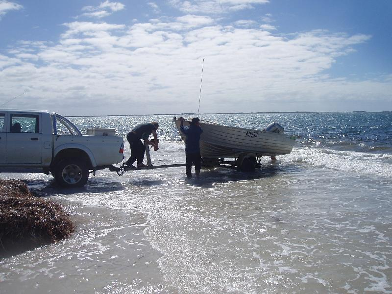 FISHING IN ESPERANCE, Fishing Photos,  Fishing Boat, Launching the tinnie off the beach at Isralite Bay, Esperance Western Australia. Russell Stone.