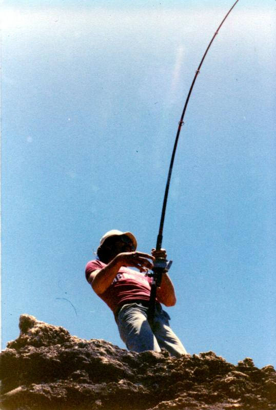 FISHING CAPE CUVIER IN THE EIGHTIES, Fishing Photos,  Action Photo, Peter hooked up at Garth's Rock, Cape Cuvier, Western Australia. Bob Fisher Cape Cuvier action photo early 1980's. SportfishWorld Copyright.