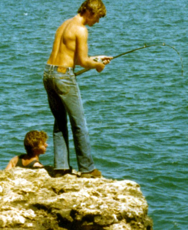 FISHING CAPE CUVIER IN THE EIGHTIES, Fishing Photos,  Action Photo, Bob fighting a Shark Mackeral at Garth's Rock, Cape Cuvier Western Australia in the 1980's... Homemade baitcasting rod based on an Ugly Stik blank. Reel was a DAM 800B baitcaster...