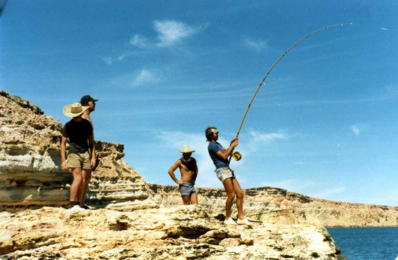 FISHING CAPE CUVIER IN THE EIGHTIES, Fishing Photos,  Action Photo, Joe fighting a big fish off Garth's Rock, Cape Cuvier in the early eighties. Bob Fisher Photo. SportfishWorld Copyright.