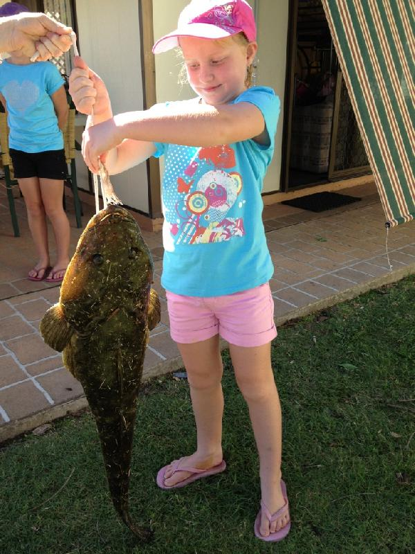 WORLDWIDE SPORTFISHING PHOTOS, Australia,   Flathead, My 7 year old Daughter Abbey landed this massive 94cm, 5kg Flathead from the shore at Lake Conjola. She caught in with a 2kg rod, a tiny bit of prawn with a jighead and 4 pound line. Sue McCartney, Lake Conjola, NSW, Australia